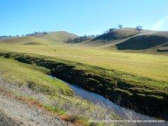 rolling hills and grasslands on Highland Rd