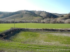 surrounding hills and fields