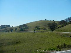 road weaves around the hills