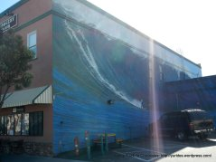 riding the waves mural on Main St