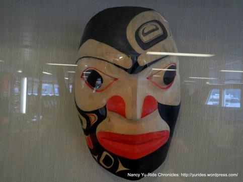 tribal mask aboard ferry