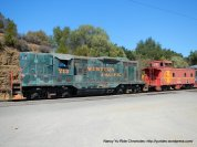 Western Pacific locomotive & red caboose