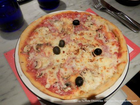 La Reine Pizza with Prosciutto, olives, mushrooms, mozzarella and tomato