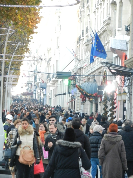 throngs of people on the Champs Elysees