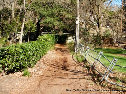 """dirt path leading thru """"hole in the fence"""""""