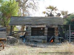 rustic log building/storage shed